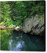Lake With Rocks In The Mountain Canvas Print by Radoslav Nedelchev
