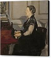 Madame Manet At The Piano Canvas Print by Edouard Manet