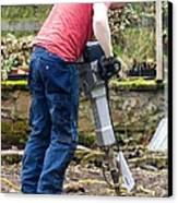Man Breaking Concrete With A Jack Hammer. Canvas Print by Mark Williamson