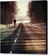 Man Walking On A Rural Winter Road Canvas Print