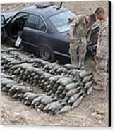 Marines Discover A Weapons Cache Canvas Print by Stocktrek Images