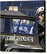 Military Policeman Stands Next Canvas Print by Michael Wood