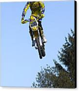Motocross Rider Jumping High Canvas Print by Matthias Hauser