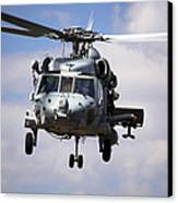Navy Pilots In A Sh-60f Seahawk Conduct Canvas Print by Michael Wood