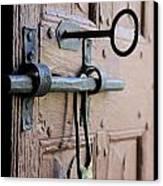 Old Door Of Wood With Its Worn Lock Canvas Print by Bernard Jaubert