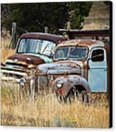 Old Farm Trucks Canvas Print by Steve McKinzie