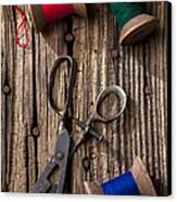 Old Scissors And Spools Of Thread Canvas Print