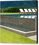 Outdoor Swimming Pool Canvas Print by Atiketta Sangasaeng