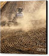 Plowing The Ground Canvas Print by Mike  Dawson