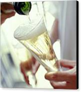 Pouring Champagne Canvas Print by David Munns