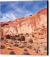 Red Rock And Blue Skies Canvas Print by Bob and Nancy Kendrick