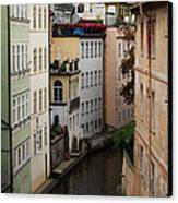 Red Rooftops In Prague Canal Canvas Print by Linda Woods
