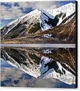 Reflection In Lake Pearson, Castle Hill Canvas Print by Colin Monteath