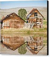 Reflection Of An Old Building Canvas Print by Donna Greene