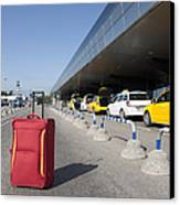 Rolling Luggage Outside An Airport Terminal Canvas Print by Jaak Nilson