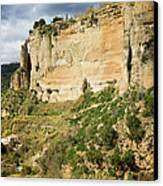 Ronda Rock In Andalusia Canvas Print by Artur Bogacki