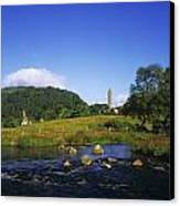Round Tower And River In The Forest Canvas Print by The Irish Image Collection