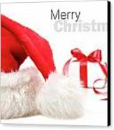 Santa Hat And Gift With Red Bow Canvas Print