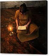 Schoolgirl Sitting On Wood Floor Reading By Candlelight Canvas Print by Jill Battaglia