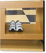 Shoes In A Shelving Unit Canvas Print by Andersen Ross