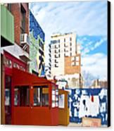 Shops On A City Street Canvas Print by Eddy Joaquim