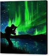 Silhouette Of Photographer Shooting Stars Canvas Print by Setsiri Silapasuwanchai