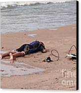 Small Surfer Lying On Beach Canvas Print by Christopher Purcell