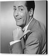 Smiling Man Pointing In Studio, (b&w), Portrait Canvas Print by George Marks