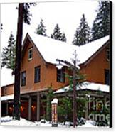 Snow Atop The Inn At Longmire Canvas Print by Kathy  White