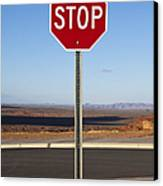 Stop Sign In The Desert Canvas Print by Paul Edmondson