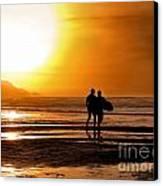 Sunset Surfers Canvas Print by Richard Thomas