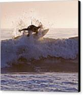 Surfer At Dusk Riding A Wave At Rincon Canvas Print