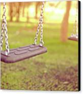 Swings In Park Canvas Print by Rob Webb
