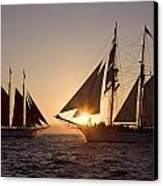 Tall Ships At Sunset Canvas Print by Cliff Wassmann