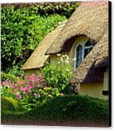 Thatched Cottage With Pink Flowers Canvas Print