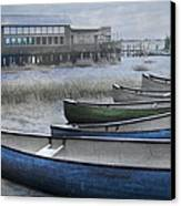 The Green Canoe Canvas Print by Debra and Dave Vanderlaan