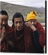Three Buddhist Lamas In Gansu Province Canvas Print by David Edwards