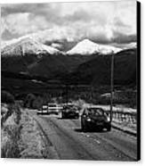 Traffic On A82 Trunk Road Through The Scottish Highlands With Snow Covered Mountains Ben More  Canvas Print