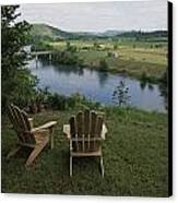 Two Adirondack Chairs On A Scenic Canvas Print by Randy Olson
