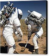 Two Astronauts Collect Soil Samples Canvas Print by Stocktrek Images