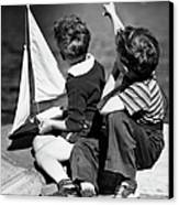 Two Boys Playing W/sailboats Canvas Print