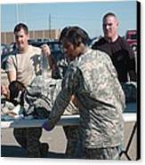 Us Army First Responders Use A Table Canvas Print