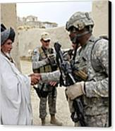 U.s. Army Soldier Shakes Hands With An Canvas Print
