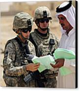 U.s. Army Soldiers Talking With A Town Canvas Print by Stocktrek Images