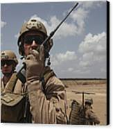 U.s. Marine Uses A Radio In Djibouti Canvas Print by Stocktrek Images