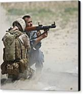 U.s. Marine Watches An Afghan Police Canvas Print by Terry Moore