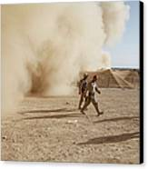 U.s. Marines Walk Away From A Dust Canvas Print by Stocktrek Images