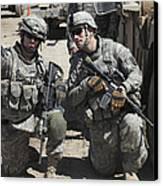 U.s. Soldiers Coordinate Security Canvas Print