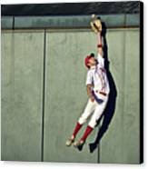 Usa, California, San Bernardino, Baseball Player Making Leaping Catch At Wall Canvas Print