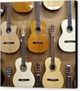Various Guitars Hanging From Wall Canvas Print